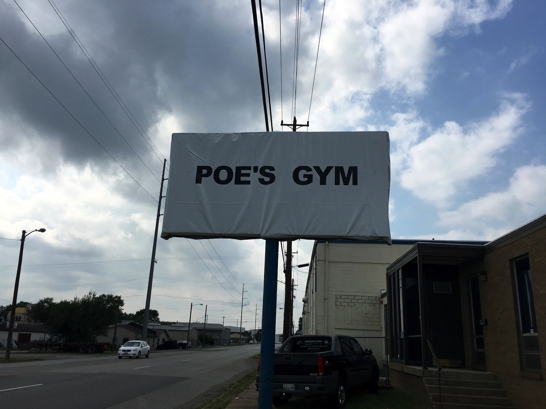 Poes Gym Sign